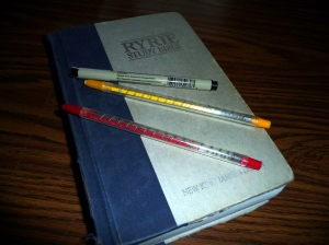 My beloved study Bible of 20 plus years and marking pen/highlighters.